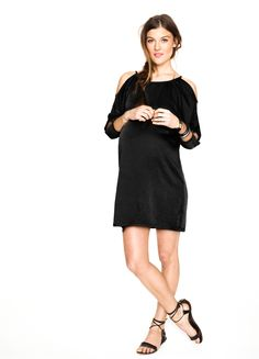Love the cut outs in the arm area. Looks very comfy and could also be worn with linen pants.