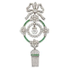 An Edwardian diamond and emerald pendant Cartier London. In original box