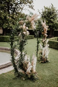 This stunning ceremony archway features greenery + pampas grass for a garden-inspired feel | Image by Aberrazioni Cromatiche Studio