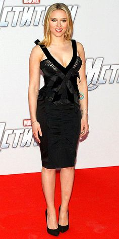 "Scarlett Johansson. Continuing to do her ""Black Widow"" character proud, the Avengers star attends the film's Moscow premiere in a sexy lace-accented Nina Ricci dress, Karma El Khalil cuff and J/Hadley ring."