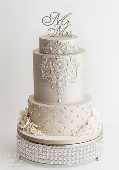 Beautiful wedding cake by De la Crème Creative Studio,their wedding cakes are beautiful contemporary not like others,bling wedding cake center-of-attention