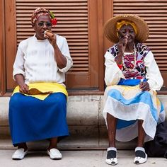 Women in typical clothing in Havana With the growth of foreign tourism people like these,working for tips,make their living posing as traditional cuban characters.