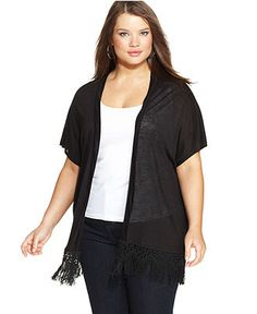 Sleeveless woven tunic featuring a scooped neckline with self tie ...