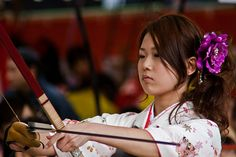 The focus of a young girl with bow...utter concentration...