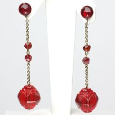 Ruby-glass beads molded into flowers are suspended from small ruby glass beads in these vibrant and versatile Art Deco pendant earrings.