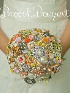 Stunning brooch bouquet! Draped pearls and a ribbon-wrapped stem.