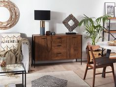 This sideboard is a classic and universal piece of furniture for your living room. Dark Brown Couch, Brown Couch Living Room, Traditional Living Room Furniture, Madeira Natural, Sombre, Storage Spaces, Armoire, Fall Decor, Legs