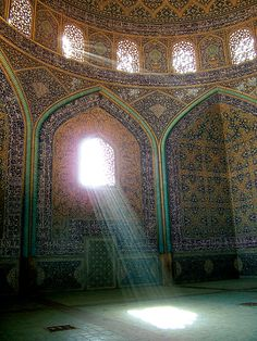 sun gushing through the window of a mosque.