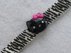 Hey, I found this really awesome Etsy listing at http://www.etsy.com/listing/175211834/black-cat-headband-zebra-stripe-headband