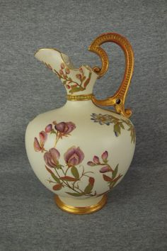 Royal Worcester Porcelain Ewer with Floral Motif Measures 10 1/2 Inches in Height