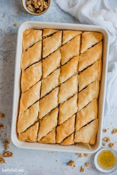 This Baklavarecipe is a showstopper dessert and loved by all at gatherings. Layers of buttery phyllo dough stacked between a cinnamon walnut filling, then finished with a honey glaze. Baked, crispy, amazing! #baklava #baklavarecipe