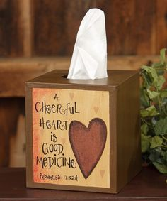 """A Cheerful Heart . Tissue Box Cover """"A Cheerful Heart is Good Medicine Proverbs Measures H x 5 W x 5 D. A beautiful country accent to any home. Primitive Crafts, Wood Crafts, Diy And Crafts, Americana Crafts, Primitive Country, Tissue Box Covers, Tissue Boxes, Kitchen And Bath Decor, Painted Wooden Boxes"""