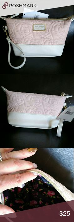 Betsy Johnson  New York cosmetic bag Soft pink and white  L 8.5 X  H5.5 X W 4  cute for traveling  or just home. Betty Johnson  Bags Cosmetic Bags & Cases