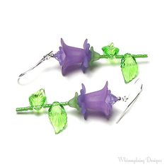 Purple Lily Earrings, Lilac Lily Flower Swarovski Crystal Silver Dangle Earrings are handmade with elongated silver finish ear wires and decorative silver finish components. Lovely purple lilac acrylic lily flower beads are accented with violet Swarovski crystals on long stems made
