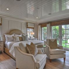Traditional bedroom w/windows over nightstands & large french doors. Ceiling covered w/painted laminate.