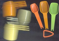 tupperware measuring cups and spoons... i still have my mama's yellow cups and the tablespoon