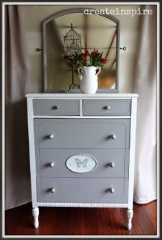 createinspire: Antique Highboy refinished in gray and white with butterfly graphic