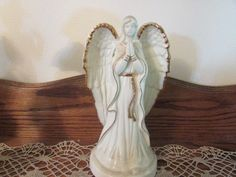 LEFTON IRISH MUSICAL ANGEL, SONG IS:  AMAZING GRACE.  Selling on eBay.  eBay item number:131552863041