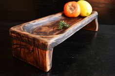 Wooden serving platter This unique wooden tray could be a great addition to your kitchen. Each item is completely handmade and with precision to detail. To make it, we have used a piece of high quality beech wood finished with hand rubbed environmentally friendly pigments and bio oil. This wooden tray is food safe - only natural materials are used - wood and bio oil. Size approximately: length: 12,09 in.(31cm.) width: 5,07 in.(13cm.) height: 2.53 in. (6.5cm.)