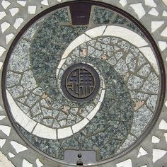 The beautiful mosaic design for a manhole in the city of Kamakura above, shows that even the most functional of objects can have artistic merit.