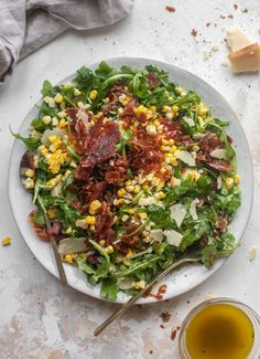 This prosciutto corn arugula salad is so simple and flavorful! Charred corn, crispy prosciutto, peppery arugula and a parmesan vinaigrette! Absolutely delish.