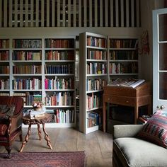 Discover bookshelf ideas on HOUSE - design, food and travel by House & Garden. This built-in bookcase equipped with a ladder also acts as a secret door to a hidden bathroom.