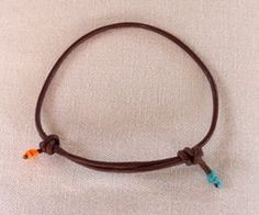 How to make slip knots for a leather cord bracelet.