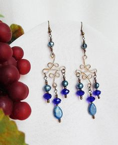 Enchanting Victorian Filigree Chandelier Earrings in gold and vibrant deep blues! Intricate handmade filigree earring frames of red brass, shower with luminous deep cobalt blue crystals, glowing blue potato pearls., and natural lapis drops! #elegancebydorianne #victorianstyle #victorianinspired #victorianjewelry #chandelierearrings #jewellery #etsy #etsyjewelry #etsyjewelryshop
