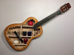 Colorado artisan Randy Rollheiser has created an absolutely gorgeous line of wall hanging shelves that are built directly into the hollowed out bodies of recycled acoustic guitars, guitar cases and … Guitar Shelf, Guitar Wall Art, Guitar Display, Guitar Crafts, Guitar Diy, Upcycled Home Decor, Repurposed, Old Musical Instruments, Wall Hanging Shelves