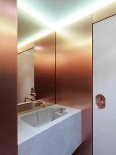 Bathroom with Rose Gold Smoked Mirrored Walls