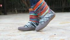 SELLING FAST!!! Fun boots made of weather-friendly faux suede and multicolored wool yarn keep feet warm in all kinds of weather.