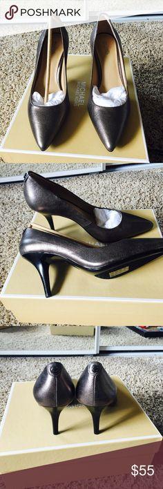 NWT Michael Kors mid flex pumps NWT MK mid flex pumps in beautiful gunmetal color! Has black heels and sole. Very soft and comfy! MICHAEL Michael Kors Shoes Heels