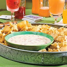 Spicy White Cheese Dip -Made-from-scratch Spicy White Cheese Dip gets its kick from canned diced tomatoes and green chilies.