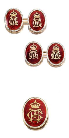 PAIR OF ENAMEL CUFFLINKS AND BROOCH/PENDANT, EARLY 20TH CENTURY.  The oval cufflinks applied with a Royal coronet and monogram 'G M', representing the initials of King George V and his wife Mary, with a red guilloché enamel background to a white enamel border of stylised ermine design together with a brooch/pendant of similar design