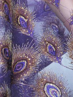 BEAUTIFUL Peacock Fabric in shades of purple with a lil bling -gold sequins!