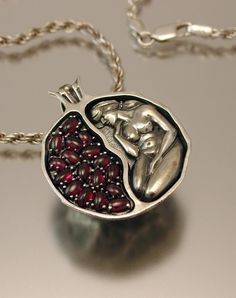 pomegranate pendant is made of silver and garnet by WingedLion