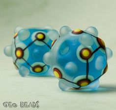 Geo Beads one pair of artisan lampwork etched beads by GlassGeoBeads $15.00 Etsy <3<3<3