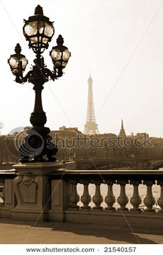 Parisian cherub lampost..with the eiffel tower in the background..gorgeous!