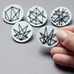 Geometric abstract brooch plastic and thread by Mouseblossom. These would make neat earrings, and you could use shrink plastic plus button thread.