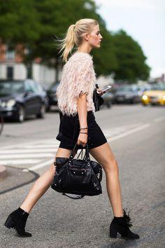 Blush top with a black mini, booties, Balenciaga bag.