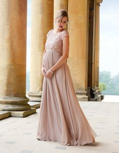 Blush Silk & Lace Maternity Gown A breathtaking maternity evening gown designed for extra special occasions, the Blush Silk & Lace Maternity Gown is a style that won't be easily forgotten. Fully lined, the romantic silk skirt drapes lavishly over your curves then down to a dramatic floor-sweeping finish. The lace bodice with intricate eyelash edging keeps your shoulders delicately covered, while chic keyhole detailing at the back reveals just a flash of skin. The style features a subtle…