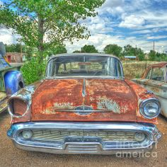 Fine Art Photography - Route 66 Oldsmobile - a colorful fine art image of a very tired and very rusty classic car found on Route 66. Photo by John Kelly  http://twitter.com/jakphoto http://facebook.com/jakphotoart http://www.pinterest.com/jakphoto http://www.jakphoto.co.uk