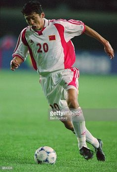 Yang Chen of China runs with the ball during the FIFA 2002 World Cup Qualifier between China and the United Arab Emirates played at the Wulihe...