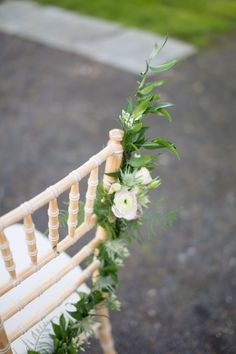 The guirland was created with soft ruscus foliage, ranunculus flowers, thistle and small garden roses.