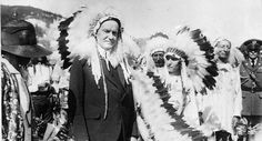 This 1927 file photo shows U.S. President Calvin Coolidge wears a Native American Indian headdress of the Sioux tribe as he is adopted as Ch...