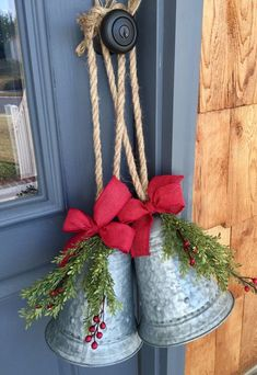 """Silver Bells... it's Christmas time in the city 🔔 Metal bells with a chic, rustic red burlap bow and Christmas berry twigs. A heavy duty rope for hanging tops off the rustic, primitive Christmas look! Purchase 1 or a set for a discounted price. ***All measurements are approximate*** From rope to bottom of bell-20"""" Bell-9.5"""" Diameter of bell at base- 22"""" NOW OFFERING FREE SHIPPING!!!!!!!!! However, If you live in a state that has astronomical shipping prices, (Example: CA, ME, WA, ID, NV"""