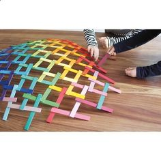 Leonardo's Little Bridge in All New | The Land of Nod. You might think of Leonardo da Vinci as the guy who painted the Mona Lisa. But, he was also the genius inventor and engineer behind this building set. This set of rainbow colored sticks can be used to create complex, self-supporting structures without using glue, tape, power tools or zoning permits.