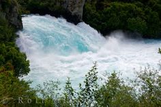 Blue Waterfall Huka Falls Taupo New Zealand:   A waterfall with a unique blue coloring to it is Huka Falls, located near Taupo on the North Island of New Zealand. A magnificent shade of blue makes up the water of Huka Falls near Taupo, New Zealand, which crashes through a fifteen to twenty meter wide opening from a river above which spans approximately one hundred meters across. Over 200,000 cubic meters of blue water thunders over the waterfall every second creating this impressive work of…
