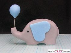 """Learn how to make this super cute """"elephant holding a balloon"""" fondant baby shower topper! Easy tutorial with a free template :)"""