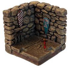 A persona touch for your dungeon - These are Dwarven Forge pieces or similar, but you can do the same with many other systems. Just add some bits to the wall or floor: shields, swords, prices, mirrors... anything that gives the feeling of a dungeon with living creatures inside.